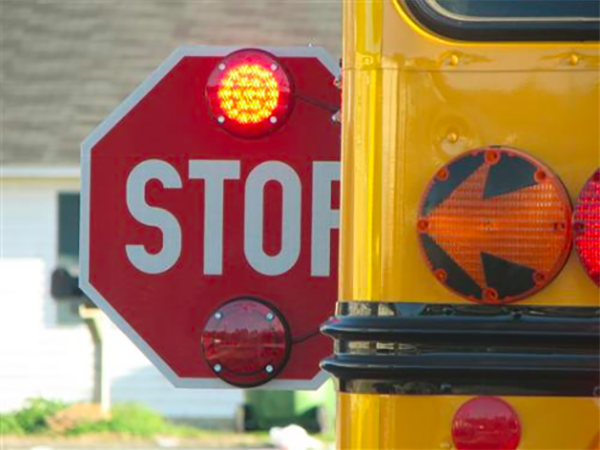 Failing to stop for a school bus has the risk of getting a traffic ticket, fine, and 4 demerit points on your license.